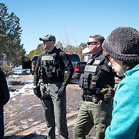 Attorney Mel O'Reilly left, Cibola County Sheriff's Deputy Julian Armijo, center left, Sgt, Nickolas Wadford, center right, and Attorney Alice Lorenz stand together before touring the compound the Aggressive Christianity Missions Training Corps (ACMTC) compound in Fence Lake Feb. 27th, 2019.