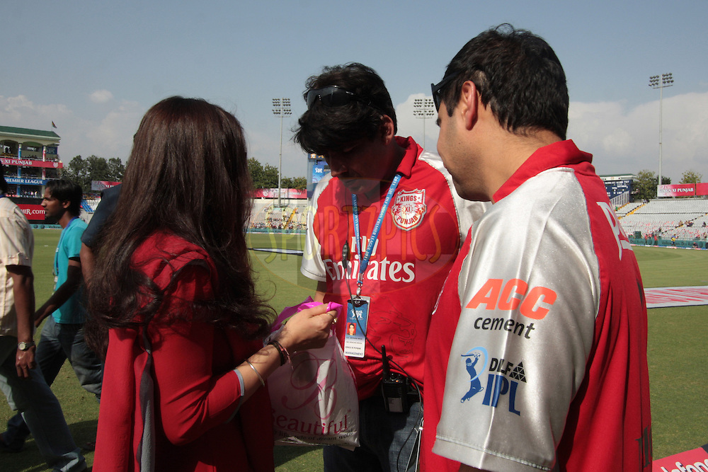 Preeti Zinta and others discuss during match 9 of the Indian Premier League ( IPL ) Season 4 between the Kings XI Punjab and the Chennai Super Kings held at the PCA stadium in Mohali, Chandigarh, India on the 13th April 2011..Photo by Anil Dayal/BCCI/SPORTZPICS