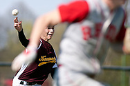 Kennedy Catholic's Scott Moore tries to throw out a West Middlesex runner after scooping up a ground ball.