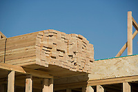Wooden planks stacked on house construction