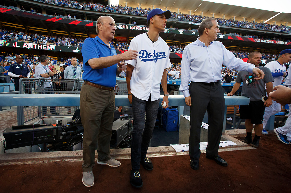 Dodgers President Stan Kasten, Lakers draft pick Lonzo Ball, center, and Lon Rosen, executive vice president and chief marketing officer for the Los Angeles Dodgers, right, hang out by the dugout before Lonzo throws out the first pitch at Dodger Stadium on Friday, June 23, 2017 in El Segundo, California. The Lakers selected Lonzo Ball as the No. 2 overall NBA draft pick and is the son of LaVar Ball. © 2017 Patrick T. Fallon