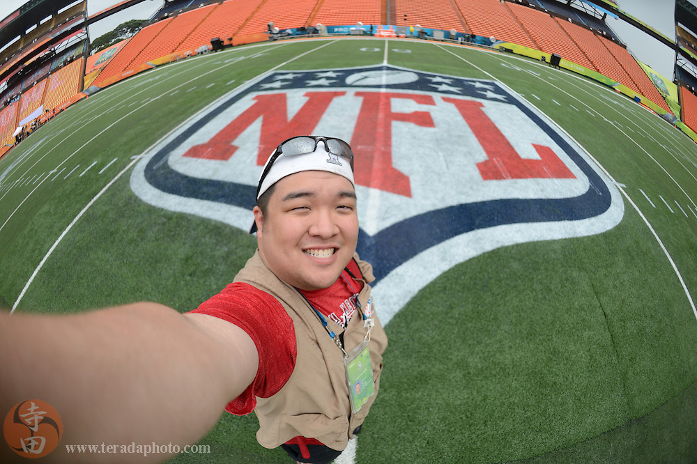 January 26, 2014; Honolulu, HI, USA; USA TODAY Sports photographer Kyle Terada before the 2014 Pro Bowl at Aloha Stadium.