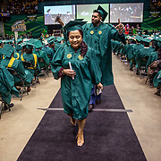 FAIRFAX, VA -DEC21: Emerita Ayala, 23, walks back to her seat after receiving her diploma during commencement at George Mason University, December 21, 2016, in Fairfax, Virginia, where she earned her bachelor's degree. It's been a long odyssey through college, Emerita started as a teenage mom at 18, with her 3-year-old son at community college. She got help through a nonprofit called Generation Hope that provides scholarships and mentoring to teenage moms. (Photo by Evelyn Hockstein/For The Washington Post)