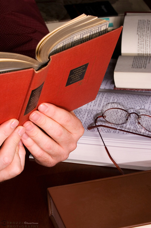 close up of hands holding a book.read reader, readers, reading, leisure, study studying hobby, hobbies,  literature, open, page, horizontal, closeup higher ed education language written word .document page cover.