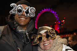 © Licensed to London News Pictures. 31/12/2017. London, UK. Revellers gather to watch the New Year's Eve fireworks at midnight . Photo credit: Peter Macdiarmid/LNP