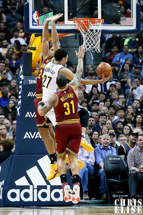 22 March 2017: Denver Nuggets guard Jamal Murray (27) goes for the layup between Cleveland Cavaliers forward Richard Jefferson (24) and Cleveland Cavaliers guard Deron Williams (31) during the Denver Nuggets 126-113 victory over the Cleveland Cavaliers, at the Pepsi Center, Denver, Colorado, USA.