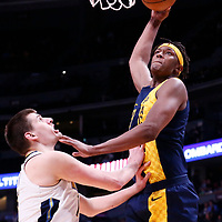 03 April 2018: Indiana Pacers center Myles Turner (33) goes for the dunk over Denver Nuggets center Nikola Jokic (15) during the Denver Nuggets 107-104 victory over the Indiana Pacers, at the Pepsi Center, Denver, Colorado, USA.