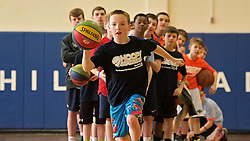 All lined up to take a shot in a p long-range hoops shoot with a basketball summer camp as prize. (Bas Slabbers/for NewsWorks)