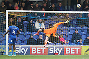 AFC Wimbledon goalkeeper George Long (1) tipping ball over during the The FA Cup match between AFC Wimbledon and Charlton Athletic at the Cherry Red Records Stadium, Kingston, England on 3 December 2017. Photo by Matthew Redman.