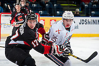 KELOWNA, CANADA - MARCH 9: Luke Harrison #17 of Prince George Cougars checks Cal Foote #25 of Kelowna Rockets on March 9, 2016 at Prospera Place in Kelowna, British Columbia, Canada.  (Photo by Marissa Baecker/Shoot the Breeze)  *** Local Caption *** Luke Harrison; Cal Foote;