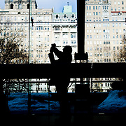 A visitor takes a photograph at the American Museum of Natural History, Hayden Planetarium, New York City, February 19, 2010.