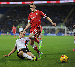 Rotherham's Scott Wootton tackles  Cardiff City's Craig Noone - Photo mandatory by-line: Alex James/JMP - Mobile: 07966 386802 - 06/12/2014 - SPORT - Football - Cardiff - Cardiff City Stadium  - Cardiff City v Rotherham United  - Football