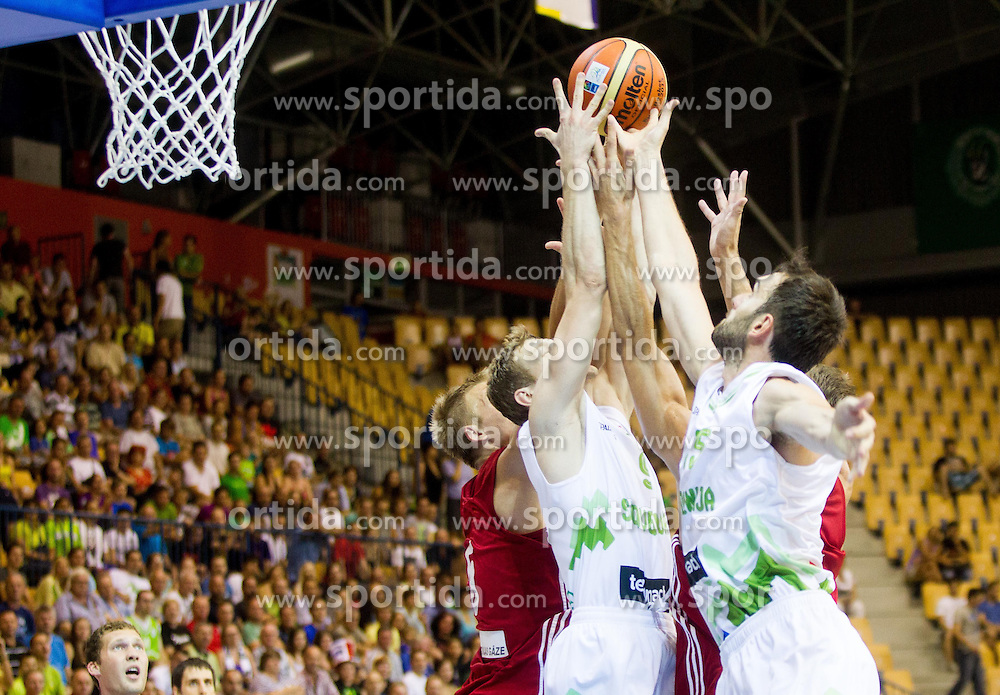 Jaka Blazic of Slovenia and Mirza Begic of Slovenia during friendly match between National teams of Slovenia and Latvia for Eurobasket 2013 on August 2, 2013 in Arena Zlatorog, Celje, Slovenia. (Photo by Vid Ponikvar / Sportida.com)