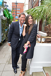 ARPAD BUSSON and ELIZABETH SALTZMAN at the launch of the new collection from Limoland held at Anderson & Sheppard's Haberdashery, 17 Clifford Street,London on 16th June 2014.
