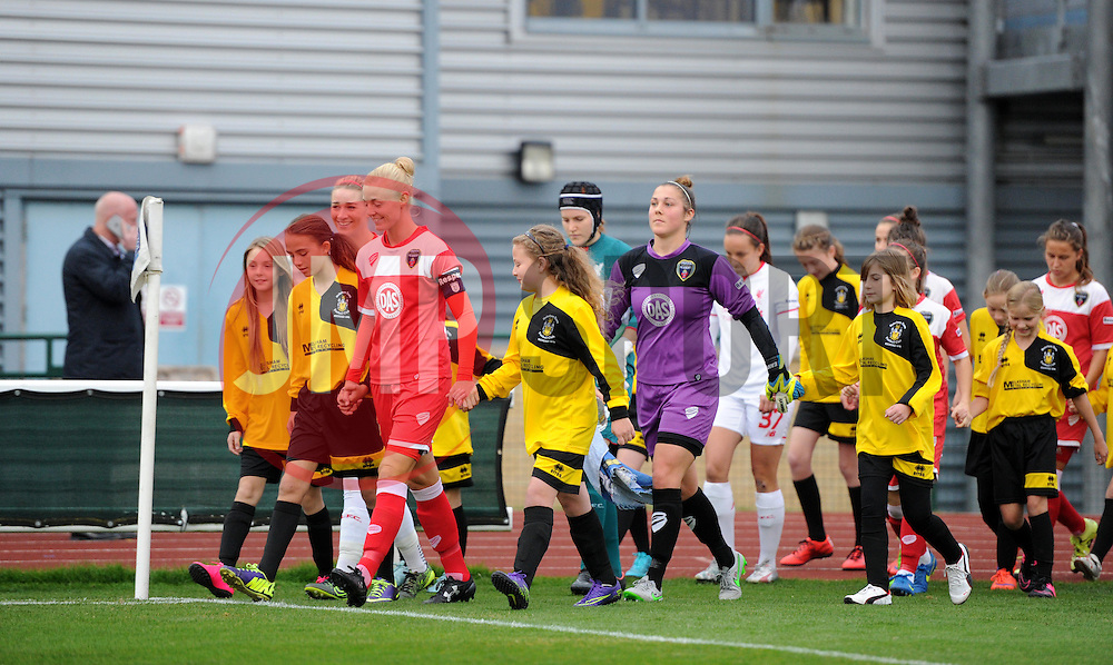 Bristol Academy Women and Liverpool Ladies players make their way on to the pitch at Stoke Gifford Stadium accompanied by mascots from Melksham Town FC - Mandatory by-line: Paul Knight/JMP - Mobile: 07966 386802 - 04/10/2015 -  FOOTBALL - Stoke Gifford Stadium - Bristol, England -  Bristol Academy Women v Liverpool Ladies FC - FA Women's Super League