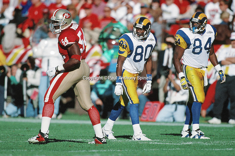 St. Louis Rams wide receiver Isaac Bruce (80) and Rams tight end Troy Drayton (84) get set to go out for a pass while defended by San Francisco 49ers linebacker Lee Woodall (54) during the NFL football game against the San Francisco 49ers on Nov. 26, 1995 in San Francisco. The 49ers won the game 41-13. (©Paul Anthony Spinelli)