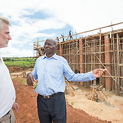 CAPTION: Technical Advisor Peter Schramm visits the Eco-Bricks site on a regular basis, where he consults with foreman John Msenda and others on progress with construction. Once the kiln is up and running, it will be able to produce up to 20,000 bricks per day. Peter says that over time, he hopes that more kilns like this will be built to service the building industries of other parts of the country as well, starting with Blantyre and Mzuzu. LOCATION: Eco-Bricks (Mthyoka), Lilongwe, Malawi. INDIVIDUAL(S) PHOTOGRAPHED: Peter Schramm (left) and John C Msenda (right).