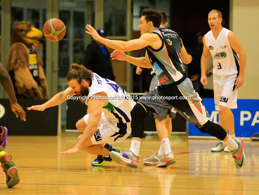 Hawk's Marco Alexander and Ranger's Casey Frank collide while chasing a lose ball. NBL basketball, Hawkes Bay Hawks  v Super City Rangers, PG Arena, Napier, New Zealand. Saturday, 18 April, 2015. Copyright photo: John Cowpland / www.photosport.co.nz