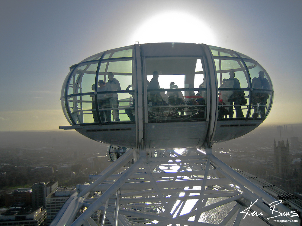 Looking into the next pod of the EDF Energy London Eye, with the sun behind. <br /> <br /> The London Eye as it is commonly known is the largest ferris wheel in Europe and was erected in 1999.