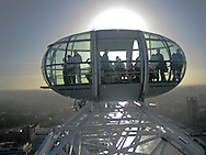 Looking into the next pod of the EDF Energy London Eye, with the sun behind. <br />