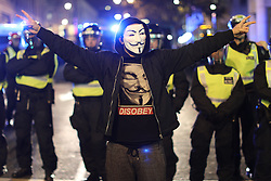 © Licensed to London News Pictures . 05/11/2016 . London , UK . Trafalgar Square. Supporters of Anonymous , many wearing Guy Fawkes masks , attend the Million Mask March bonfire night demonstration , in central London . Photo credit : Joel Goodman/LNP