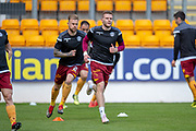 Chris Cadden (#7) of Motherwell FC leads his team mates in the warm up before the Ladbrokes Scottish Premiership match between St Johnstone and Motherwell at McDiarmid Stadium, Perth, Scotland on 11 May 2019.