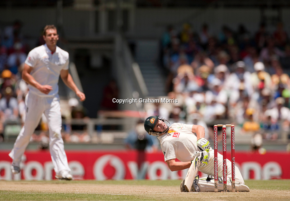 Steve Smith is floored by a Chris Tremlett delivery during the third Ashes test match between Australia and England at the WACA (West Australian Cricket Association) ground in Perth, Australia. Photo: Graham Morris (Tel: +44(0)20 8969 4192 Email: sales@cricketpix.com) 18/12/10