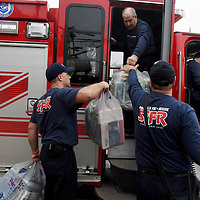 Firefighters with Sioux Falls Fire Rescue Randy Wold (clockwise from top), Scott Rieland,  Mike Thier Jon Sanders drop off donations at the fifth annual Feminine Hygiene Product Drive drop off event at Prairie Berry East Bank on Monday, Jan. 16, 2017. In January 2013, President Barack Obama called for a National Day of Service that coincided with the Martin Luther King Jr. Weekend of Service. Several Sioux Falls organizations partnered to answer President Obama's call to action by participating in the National Day of Service. The organizations collected feminine product donations for The Banquet, helping to fill a specific need for the homeless community. 2017 partnering organizations include: Downtown Sioux Falls, Inc., Fresh Produce, Sioux Falls Up & Coming, Sioux Empire Rock-a-Bettys, Prairie Berry East Bank, and new this year – The Sioux Falls Roller Dollz. In the past four years, the collective group has donated over 47,600 individually wrapped items to The Banquet.2017 partnering organizations include: Downtown Sioux Falls, Inc., Fresh Produce, Sioux Falls Up & Coming, Sioux Empire Rock-a-Bettys, Prairie Berry East Bank, and new this year – The Sioux Falls Roller Dollz. In the past four years, the collective group has donated over 47,600 individually wrapped items to The Banquet.