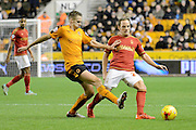 Nottingham Forest midfielder David Vaughan plays the ball away from Wolverhampton Wanderers midfielder Dave Edwards during the Sky Bet Championship match between Wolverhampton Wanderers and Nottingham Forest at Molineux, Wolverhampton, England on 11 December 2015. Photo by Alan Franklin.