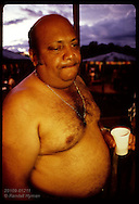 Manuel Carvalho, wealthy merchant/rancher, parties barechested at his ranch near Eirunepe, AM. Brazil