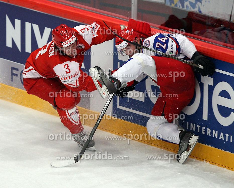 10.05.2012, Ericsson Globe, Stockholm, SWE, IIHF, Eishockey WM, Daenemark (DAN) vs Russland (RUS), im Bild Denmark 3 Philip Larsen (Dallas Stars) checks Russia 24 Alexander Popov (Avangard Omsk) // during the IIHF Icehockey World Championship Game between Danmark (DAN) and Russia (RUS) at the Ericsson Globe, Stockholm, Sweden on 2012/05/10. EXPA Pictures © 2012, PhotoCredit: EXPA/ PicAgency Skycam/ Morten Christensen..***** ATTENTION - OUT OF SWE *****