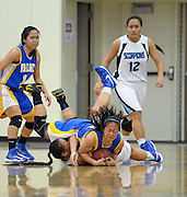 Valencia's Erika Pagkalinawan rolls over on top of Camarillo's Geraldynn Leaupepe while fighting for possession of the ball during the first round of CIF-Southern Section playoffs at Adolfo Camarillo High School on February 16, 2013.