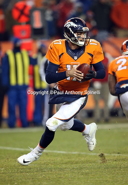 Denver Broncos quarterback Brock Osweiler (17) rolls to his right as he looks to pass in overtime during the 2015 NFL week 16 regular season football game against the Cincinnati Bengals on Monday, Dec. 28, 2015 in Denver. The Broncos won the game in overtime 20-17. (©Paul Anthony Spinelli)