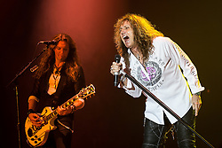 © Licensed to London News Pictures . 15/12/2015 . Manchester , UK . JOEL HOEKSTRA and DAVID COVERDALE . Whitesnake perform at the Manchester Arena . Photo credit : LNP