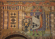 Mosaic of a man holding the Prussian standard with iron cross and eagle, a cushion with the crown and sceptre and a shield with the Prussian eagle, in the Kaiser Wilhelm Memorial Church or Kaiser Wilhelm Gedachtniskirche, built 1890s but badly damaged in a bombing raid in 1943, on Breitscheidplatz, Berlin, Germany. The church is named after Kaiser Wilhelm I, 1797-1888, and was designed by Franz Schwechten in Romanesque Revival style. Picture by Manuel Cohen