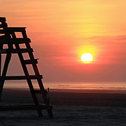 Lifeguard chair silhouette at dawn, Wildwood Crest, New Jersey. USA
