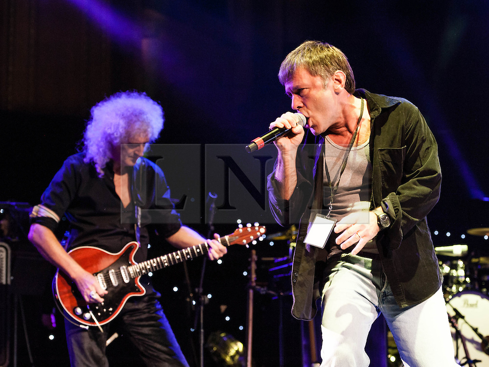 """© Licensed to London News Pictures. 16/09/2012. London, UK.  Brian May and Bruce Dickinson perform at The Sunflower Jam at the Royal Albert Hall.  Brian May is a founding member and guitarist of Queen, and Bruce Dickinson is a founder member and singer of Iron Maiden.  The Sunflower Jam is a British charity, founded by Jacky Paice, wife of Deep Purple drummer, Ian Paice. Other high-profile supporters are the actor Jeremy Irons, ex-Jamiroquai bassist Nick Fyffe and Charles, Prince of Wales. The aims of the charity are to fund complementary therapists and spiritual healers to work on cancer wards in the British National Health Service. After setting up a meeting between members of Deep Purple and a young boy dying of leukemia, Paice saw """"all the good work the healers were doing"""" and decided """"lets find a way to raise money to get more healers in there. Photo credit : Richard Isaac/LNP"""