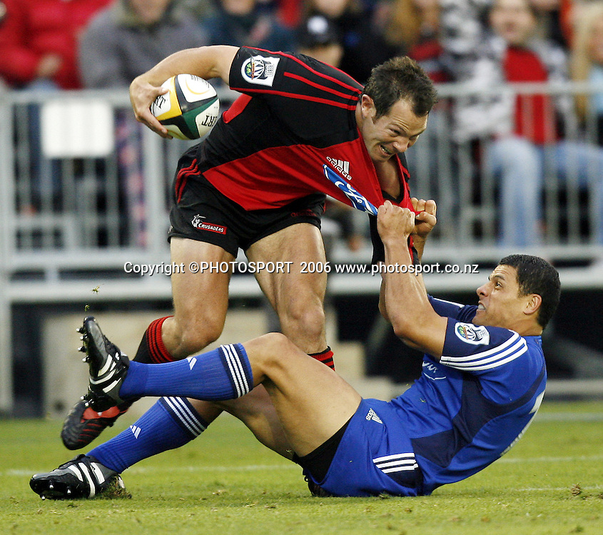Leon MacDonald caught by Doug Howlett during the 2006 Super 14 Rugby Union match between the Crusaders and the Blues at Jade Stadium, Christchurch, on Saturday 4 March 2006. Photo: Anthony Phelps/PHOTOSPORT