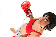 Female boxer with red handshoes, isolated in white