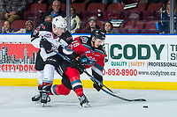 KELOWNA, CANADA - NOVEMBER 10: Tyler Benson #17 of the Vancouver Giants stick checks Carsen Twarynski #18 of the Kelowna Rockets during third period on November 10, 2017 at Prospera Place in Kelowna, British Columbia, Canada.  (Photo by Marissa Baecker/Shoot the Breeze)  *** Local Caption ***