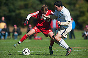 Essex's Noah Ferris (21) and CVU's Nate Coffin (14) battle for the ball during the boys soccer game between the Champlain Valley Union Redhawks and the Essex Hornets at Essex High School on Saturday mooring October 10, 2015 in Essex. (BRIAN JENKINS/For the FREE PRESS)