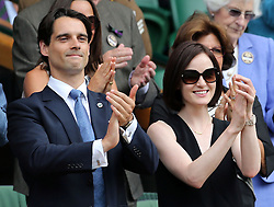 Image ©Licensed to i-Images Picture Agency. 26/06/2014. London, United Kingdom. Michelle Dockery and boyfriend John Dineen applaud from the Royal Box after Rafael Nadal's win on day four of the Wimbledon Tennis Championships. Picture by Stephen Lock / i-Images