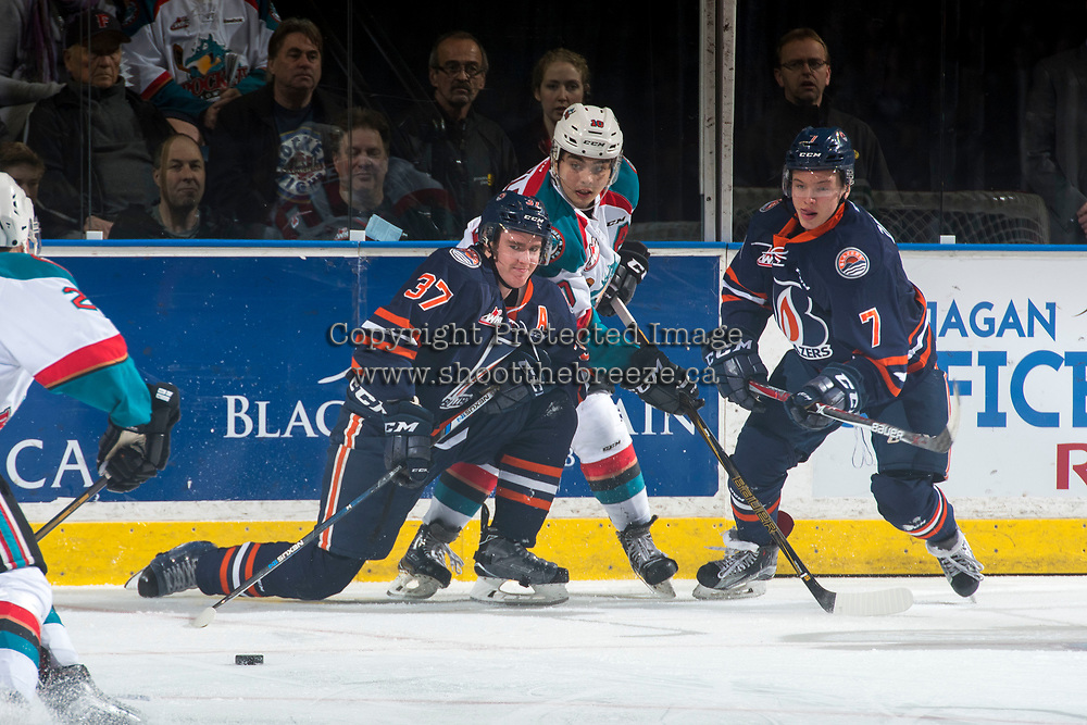 KELOWNA, CANADA - MARCH 24: Nick Merkley #10 of the Kelowna Rockets checks Joe Gatenby #37 and Luke Zazula #7  of the Kamloops Blazers during first period on March 24, 2017 at Prospera Place in Kelowna, British Columbia, Canada.  (Photo by Marissa Baecker/Shoot the Breeze)  *** Local Caption ***