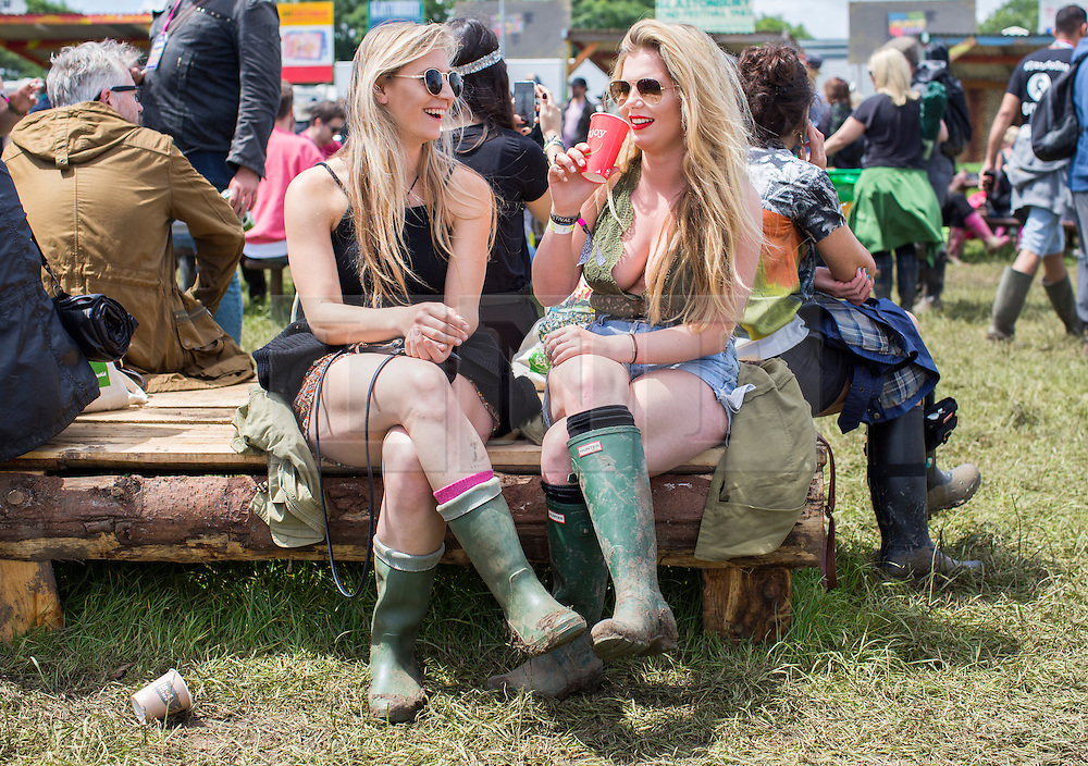 © Licensed to London News Pictures. 24/06/16. Sally Scott 20 from Kendal and Katie Preston, 20 from London enjoy the sunny weather today at the Glastonbury Festival in Pilton, Somerset. Photo credit should read Brad Wakefield/LNP