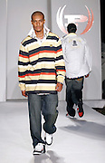 Models wearing Phat Farm work the runway at the Funkshion Fashion Week show Wednesday, March 22, 2006 in Miami, Florida.