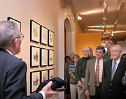 16399Fred Harris Art opening at the Kennedy Museum of Art: Photos Celeste Elliott..Fredick Harris gives some of the history behind his watercolor paintings at the exhibition opening in the Kennedy Museum  Thursday night April 15,2004. Harris is holding is the Japanese brush set he using for all his work in his right hand.