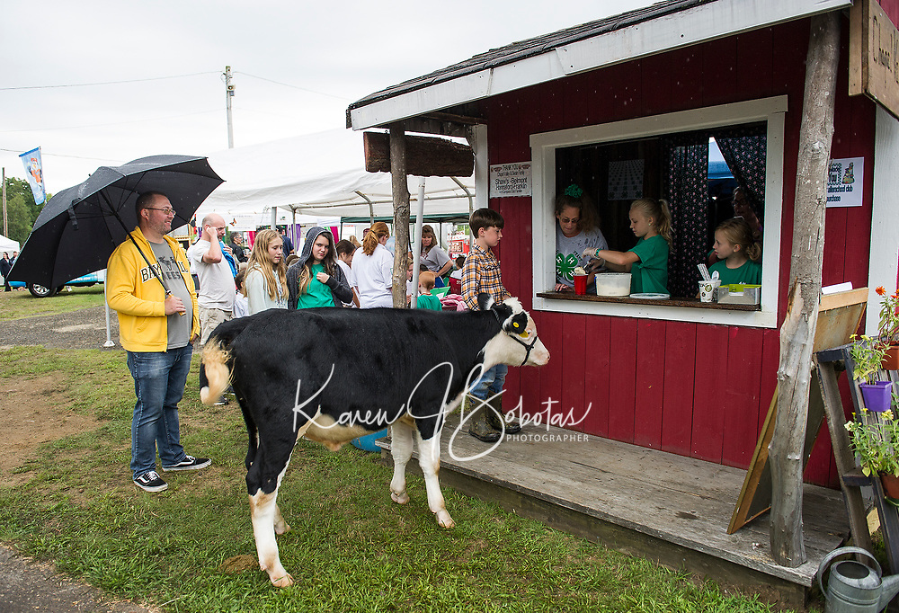 "David Swain and ""Jack"" order up a root beer float from Sandreley Henderson, Roxy Morrison and Valerie Morrison during the 4H Fair at the Belmont Fairgrounds Saturday afternoon.  (Karen Bobotas/for the Laconia Daily Sun)"