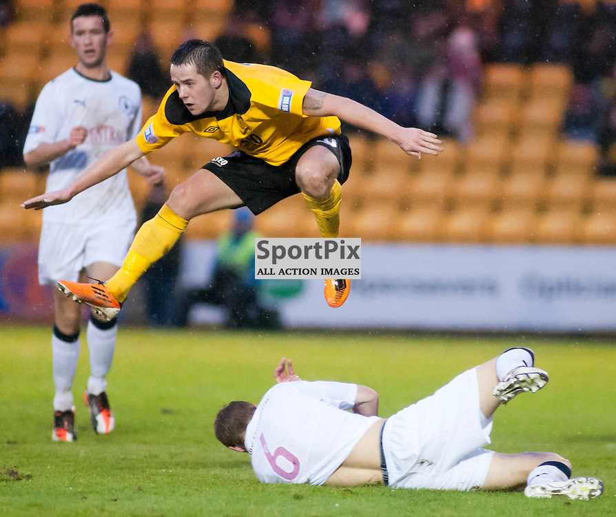 Marc McNulty hurdles the challenge of Jay Fulton, Livingston v Falkirk, SFL Division 1, Braidwood Motor Company Stadium, Monday 2nd January 2012