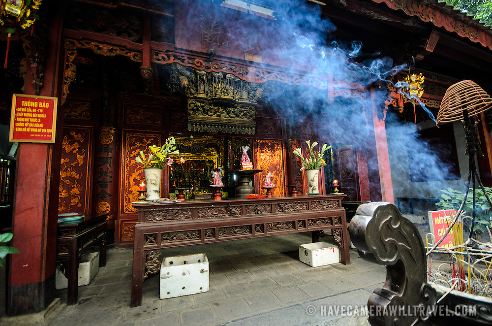 Blue smoke from the burning incense wafts through the air outside Quan Thanh Temple in Hanoi. The Taoist temple dates back to the 11th century and is located close to West Lake.