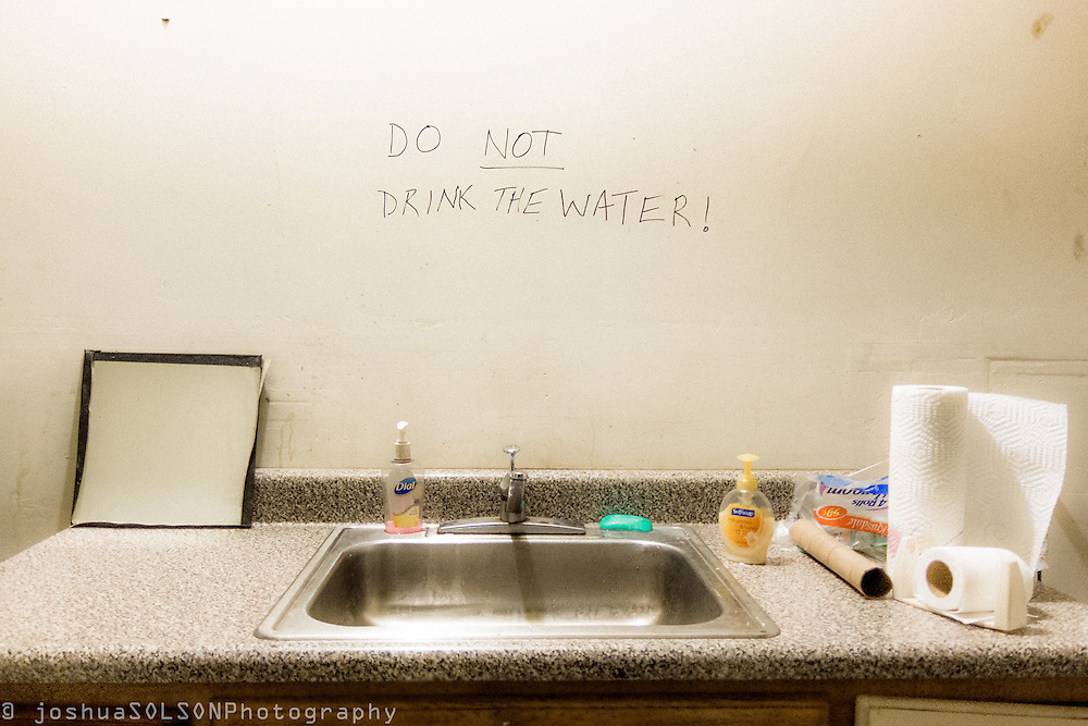 part of An Ironic Look at Water Supply series in muted color tone. Do Not Drink the Water by joshua SOLSON